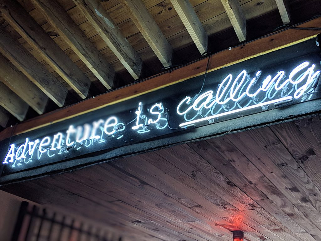Adventure is calling sign at Back Porch Bar and Grill, Ft Lauderdale